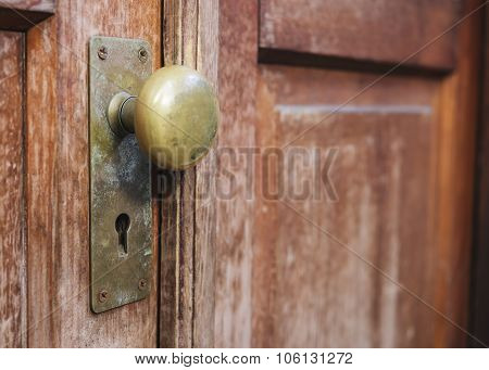 Old Doorknob With Keyhole On Wooden Door