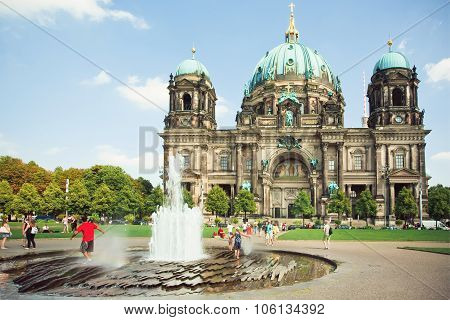 Kids Jumping In The Fountain In Front Of The Berliner Dom