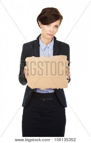 Sad fired businesswoman with a cardboard.