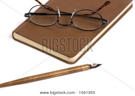 Book With Pen And Glasses