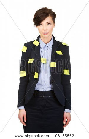 Businesswoman with adhesive cards on jacket.