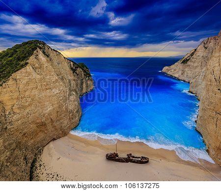 Dramatic view of beautiful Shipwreck Bay in stormy weather, Navagio Beach on Zakynthos Island in Greece.