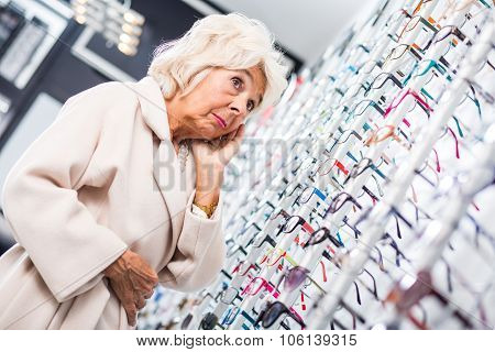 Worried Woman In Optical Shop