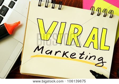 Notepad with viral marketing concept.