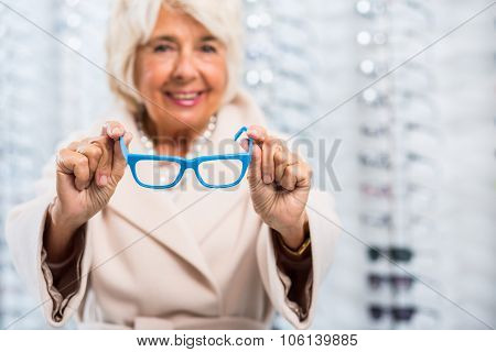 Holding Glasses With Blue Frame