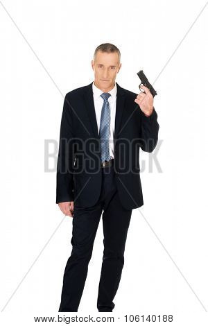 Serious mafia agent with handgun.