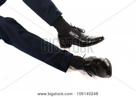 Close-up of businessman feet in black boots.