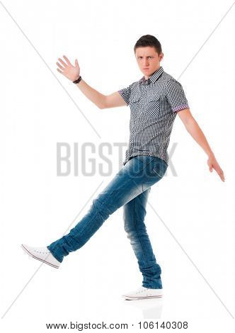 Full length portrait of a young angry man, isolated on white background