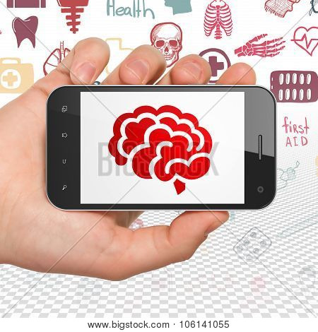 Health concept: Hand Holding Smartphone with Brain on display