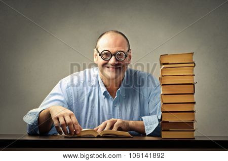 Clever man reading a pile of books