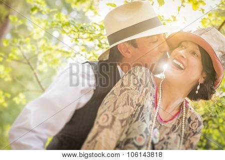 Attractive 1920s Dressed Romantic Couple Flirting Outdoors.
