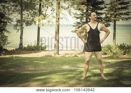Goofy Gentleman Dressed in 1920s Era Swimsuit Holding Suitcases on Porch of Cabin.