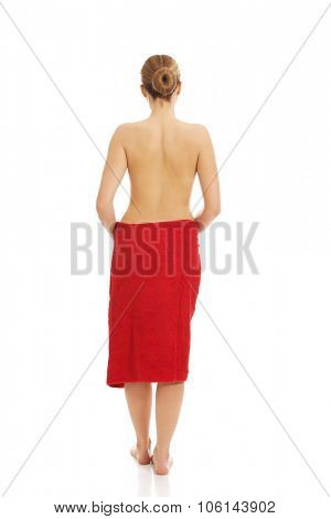 Beautiful topless woman wrapped in towel.