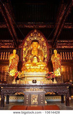 Buddhist Temple. Golden statue of Buddha