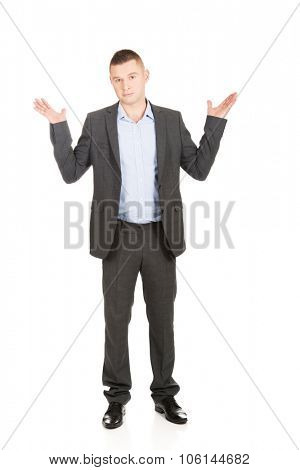 Young businessman making undecided gesture.