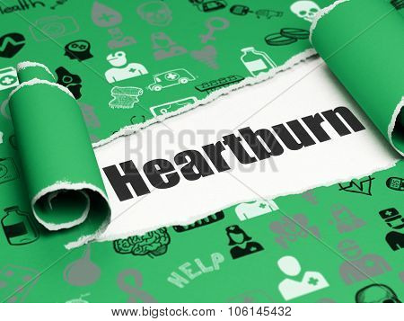 Healthcare concept: black text Heartburn under the piece of  torn paper
