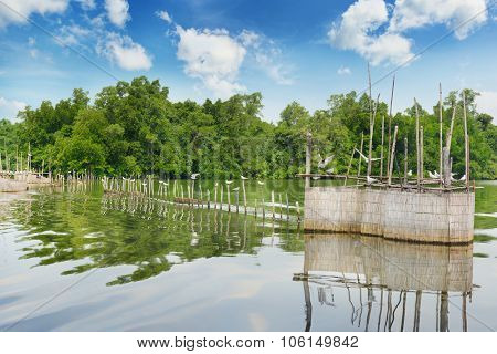 fence for fishing in the lake