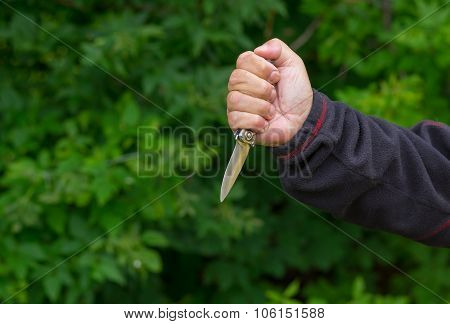 Man arm holding self-made knife