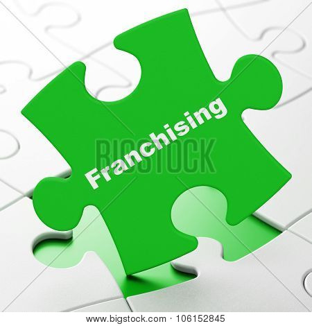 Business concept: Franchising on puzzle background