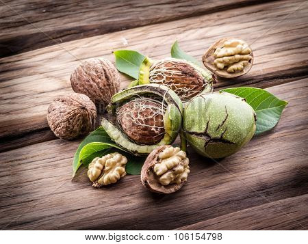 Walnut and walnut kernel on the wooden table.