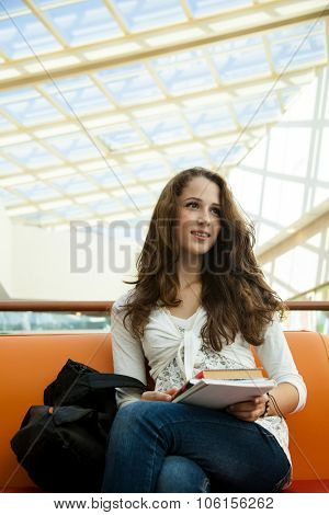 Beauty student in campus with book