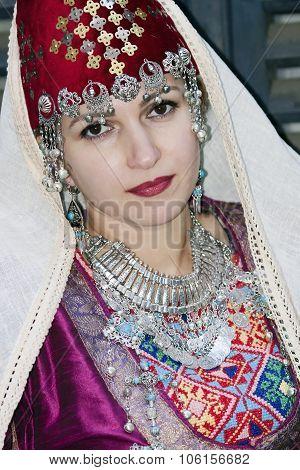 Portrait beautiful lady in the Armenian folk clothing