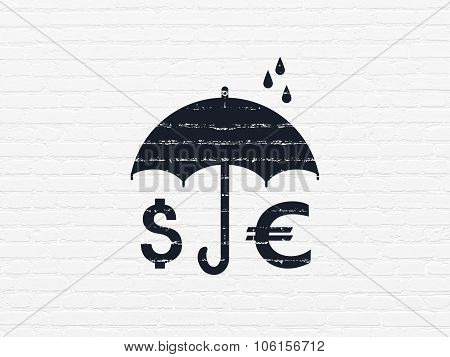 Protection concept: Money And Umbrella on wall background
