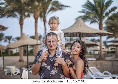 Family Mother, Father And Child Portrait On The Beach
