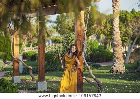 Model A Beautiful Woman Amid A Tropical Garden