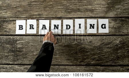 Top View Of Businessman Assembling The Word Branding