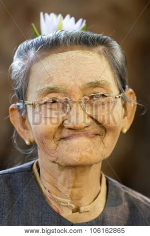 BAGAN, MYANMAR, JANUARY 24, 2015 : Portrait of a sweet and cheerful senior Burmese woman in the village of old Bagan, Myanmar (Burma).