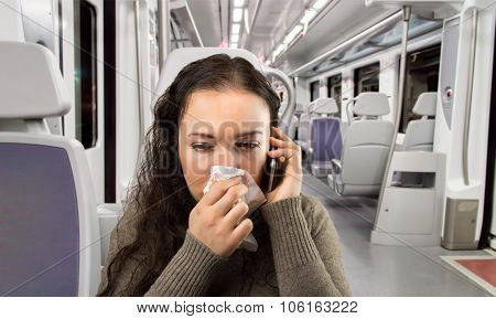 Sick Woman Travelling By Train Calling By Phone