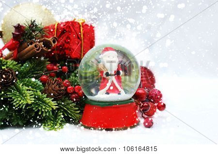 Christmas background with Santa Claus in a snow globe