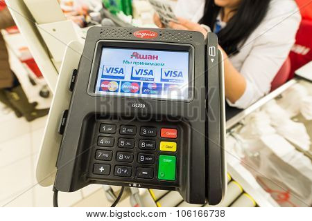 Moscow, Russia, February 1, 2015: Pos terminal, and supermarket customers paying their shopping to c