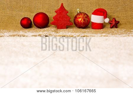 Red christmas decoration isolated and white snow .