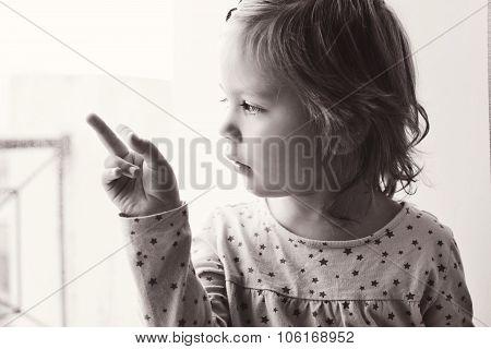 Toddler Near The Window