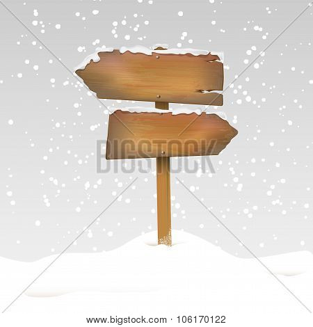 Snowy Wooden Signpost