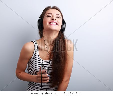 Laughing Young Woman In Headphones Listening The Mp3 Player
