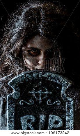 Creepy Latina Teen Girl With Tombstone