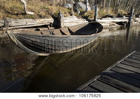 Wooden Rowing Boat Tied Up