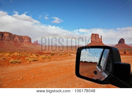 Monument Valley in the Navajo Indian Reservation. Arizona, USA. The unique red sandstone buttes are reflected in the car mirror