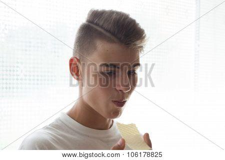 Teenager Eating Crisps