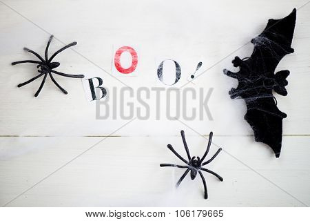Halloween Symbols Web And Black Spiders On Wooden Background