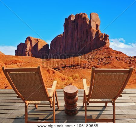 Two wooden deck chairs on the platform are to review rock