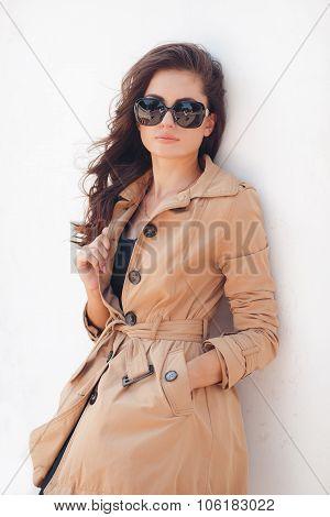Portrait of a beautiful brunette in autumn colors