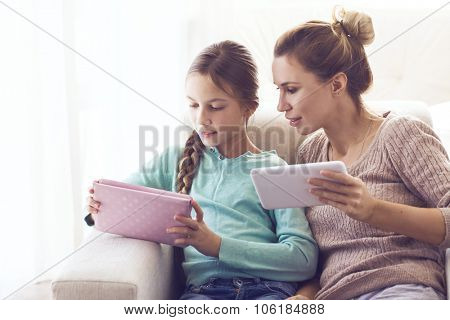 Mom with her pre teen daugher using together