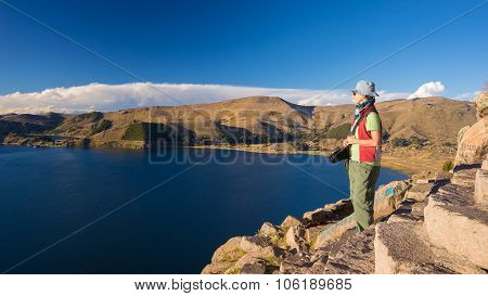 Tourist Looking At View From Above, Titicaca Lake, Bolivia