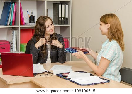 The Girl Holds A Stack Of Diplomas In Hr Office