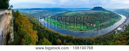 View from viewpoint of Bastei in Saxon Switzerland Germany to the town city and the river Elbe on a sunny day in autumn