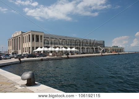 Bulding On Molo Bersagliery In Trieste, Italy On Summer Day.